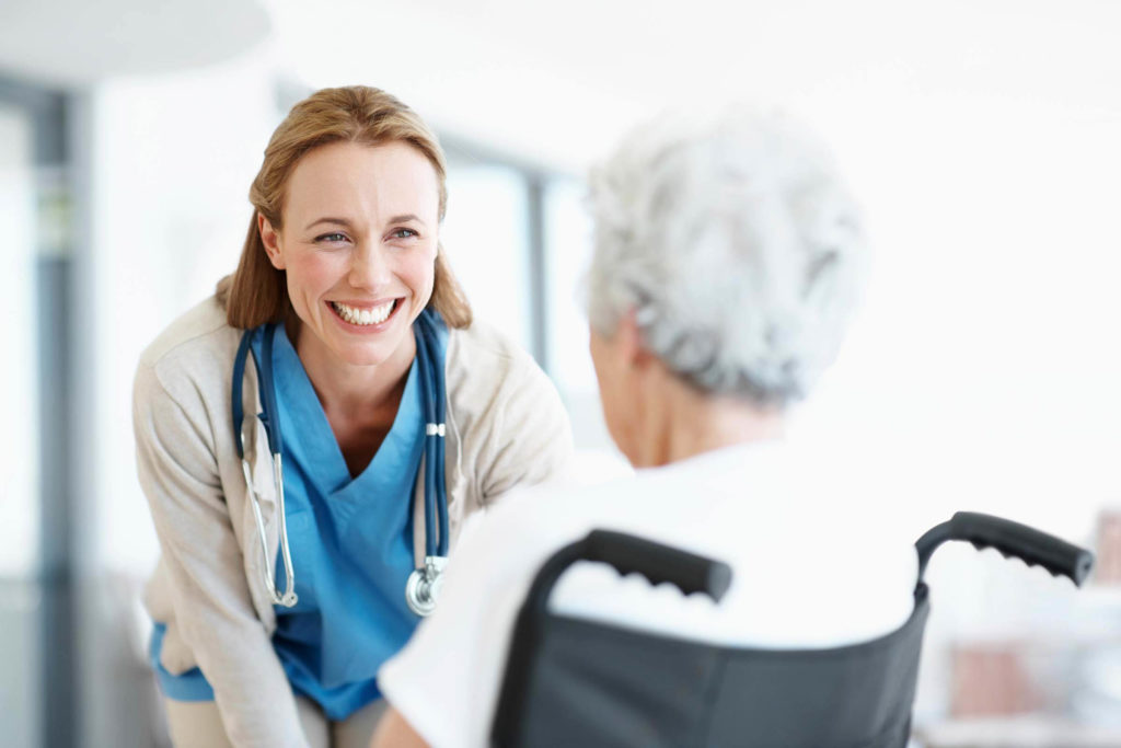 Smiling doctor with dialysis patient