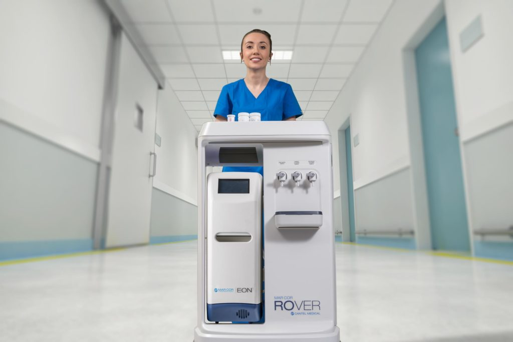 Nurse pushing portable dialysis cart