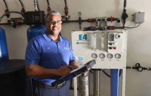 Purica High Purity Water System with technician